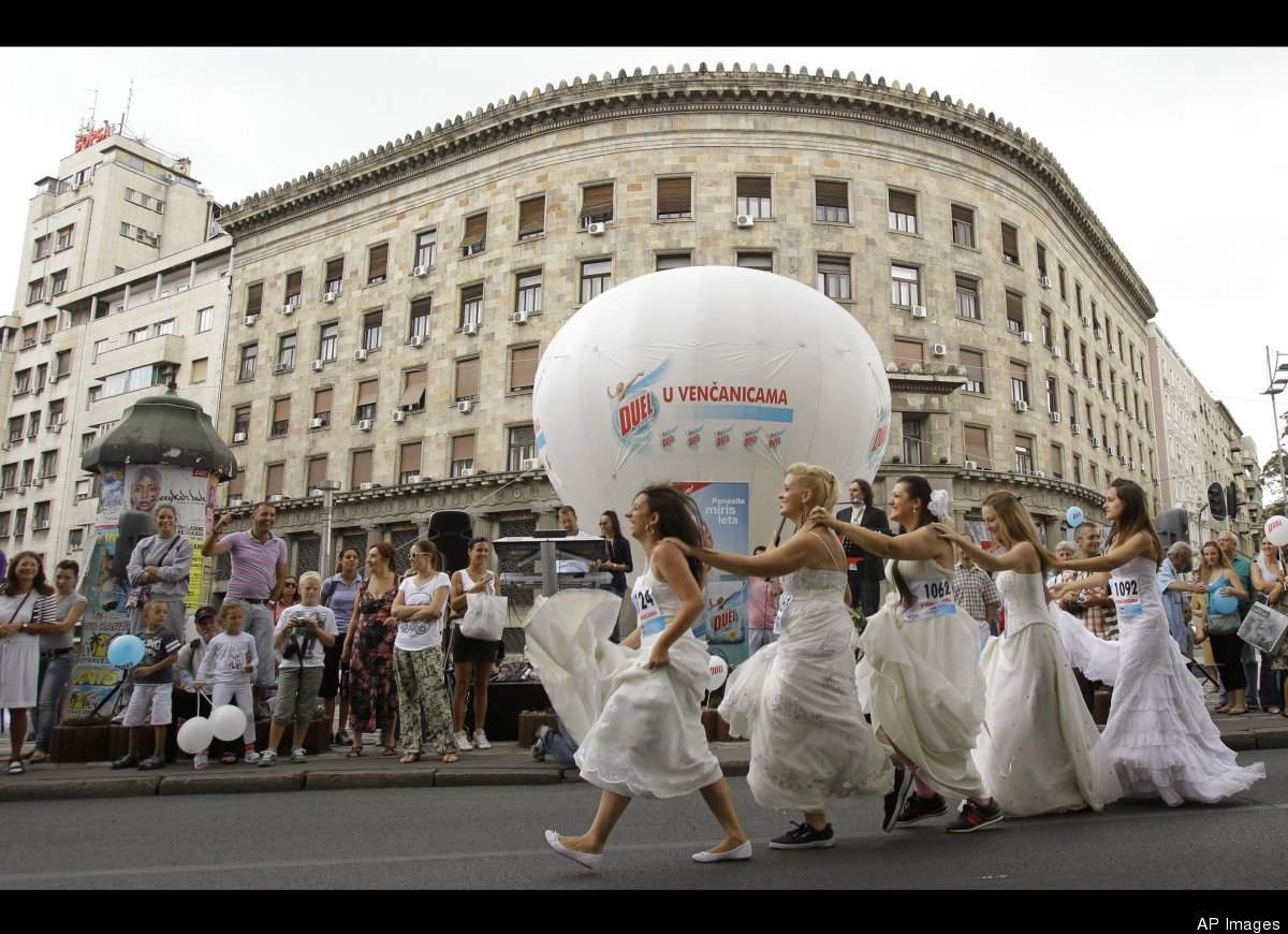 Brides prepare for a race in central Belgrade, Serbia, Sunday, July 22, 2012. The winner and two runners-up of the Bridal Rac