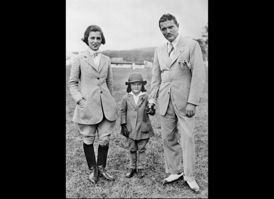 In the American countryside -- Jacqueline Kennedy Onassis as a child with her parents John Vernou Bouvier III and Janet Lee B