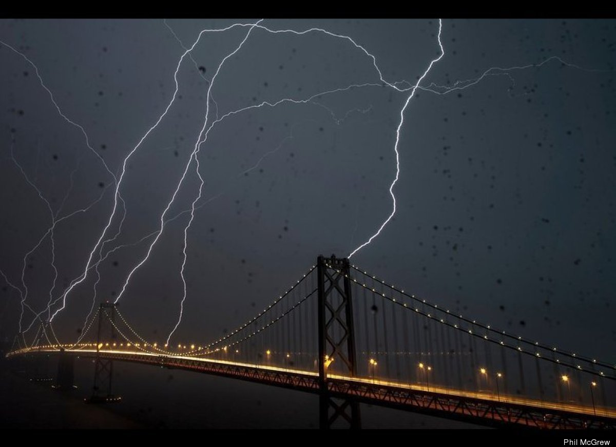 """<a href=""""http://www.philmcgrew.com/"""" target=""""_hplink"""">Phil McGrew</a>'s picture of eight bolts of lightning hitting the Bay B"""