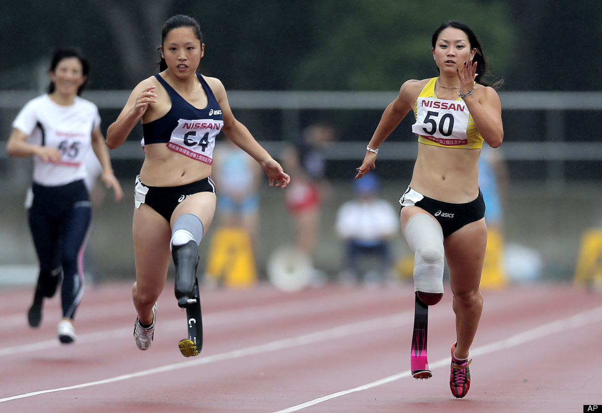 In this photo taken Saturday, July 7, 2012, Paralympic athlete Maya Nakanishi, right, competes with Saki Takakuwa in the wome