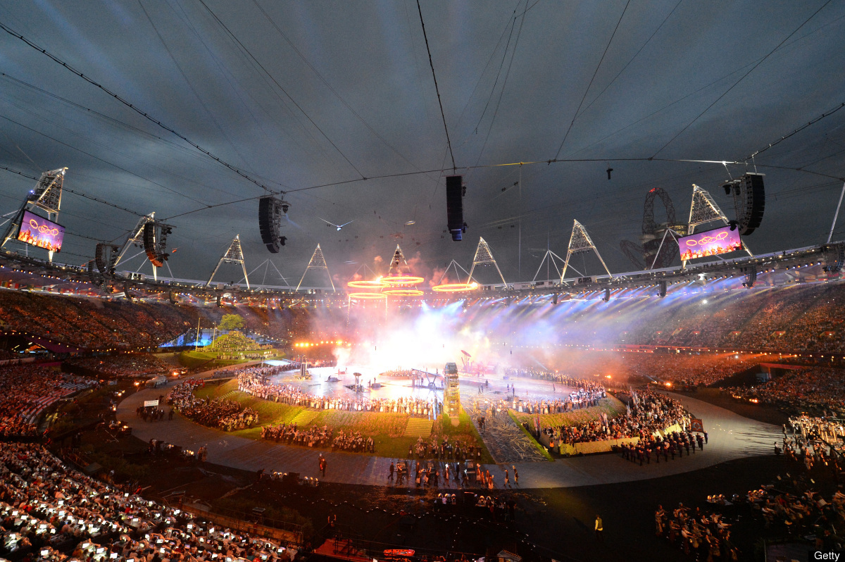 The five Olympic rings rise above a scene depicting the era of the Industrial Revolution during the Opening Ceremony of the L