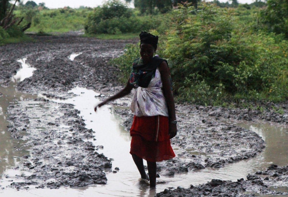 A woman navigates the muddy waters in Akobo, South Sudan.