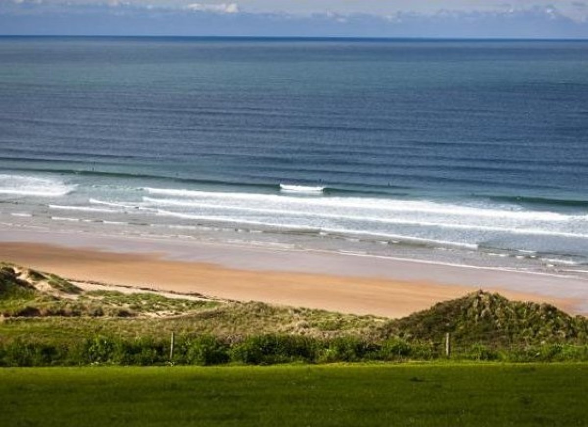 """This is Freshwater West, arguably the most beautiful beach in <a href=""""http://www.islands.com/destination/wales"""" target=""""_hpl"""