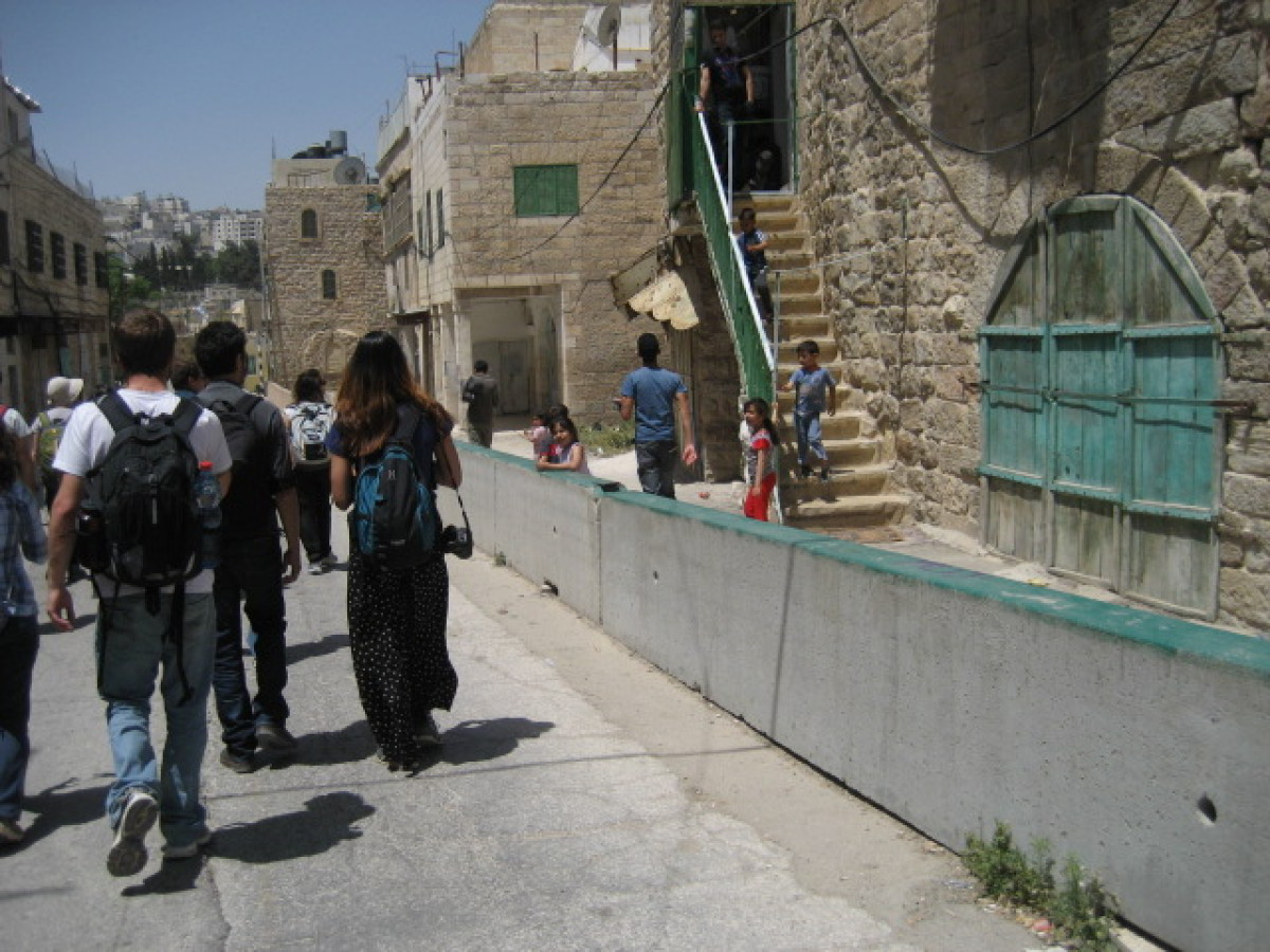 Tour group walking down Shuhada Street in Hebron.