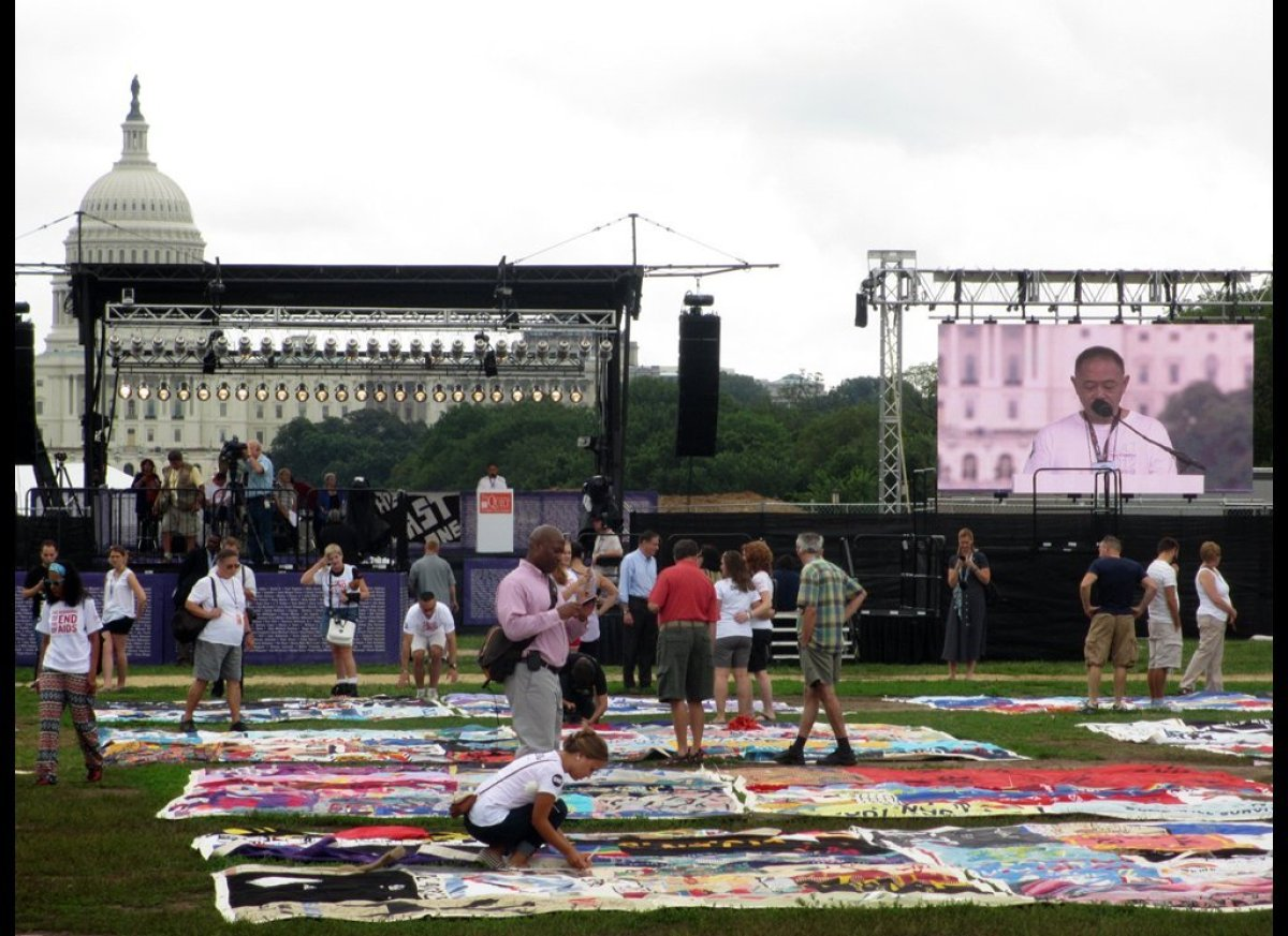 People view AIDS Memorial Quilt on National Mall, July 22, 2012. Photo: Liz Highleyman.