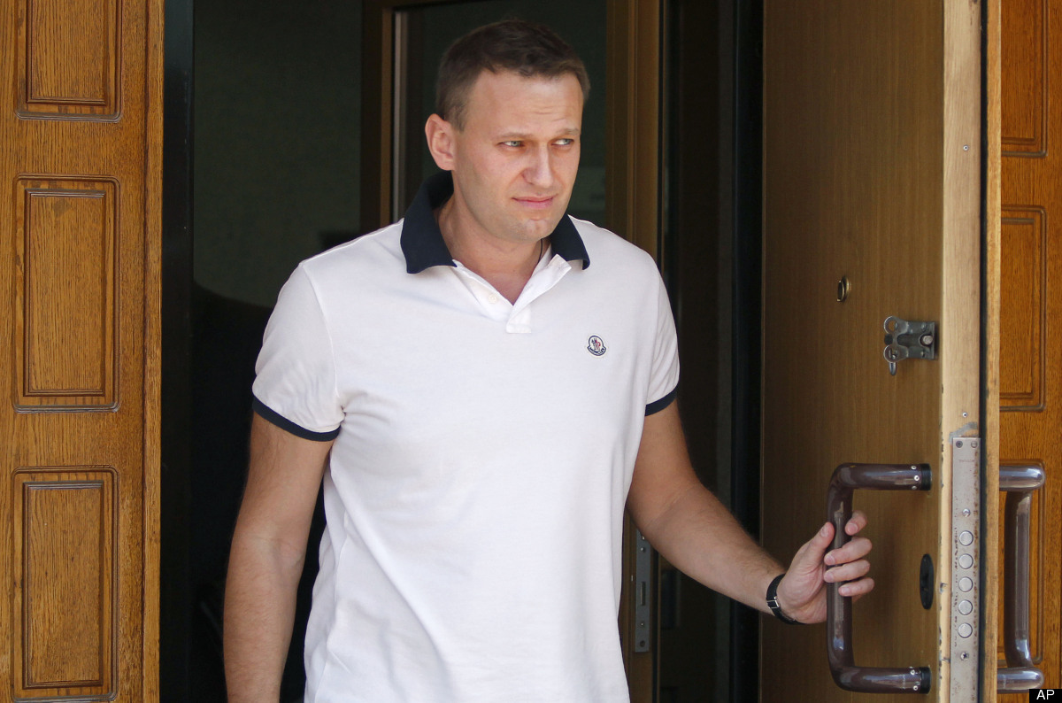 Russian protest leader Alexei Navalny leaves the offices of the Russian Investigation committee in Moscow, Russia, Tuesday, J