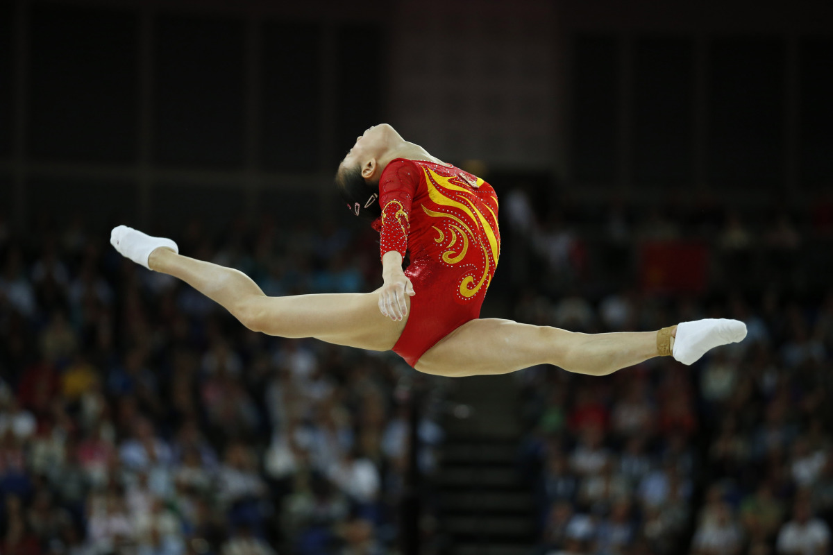 Chinese gymnast Sui Lu performs on the balance beam during the Artistic Gymnastics women's team final at the 2012 Summer Olym