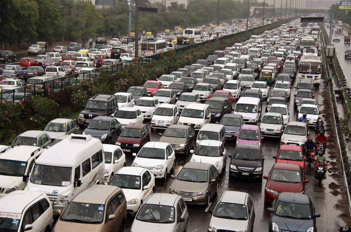 A traffic jam following power outage and rains at the Delhi-Gurgaon road on the outskirts of New Delhi, India, Tuesday, July