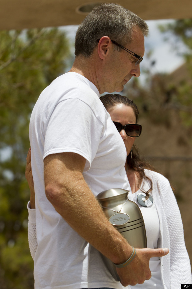 Tom Teves, left, with his wife Caren Teves, holds their son's Alex ashes, while briefing media after his memorial service at