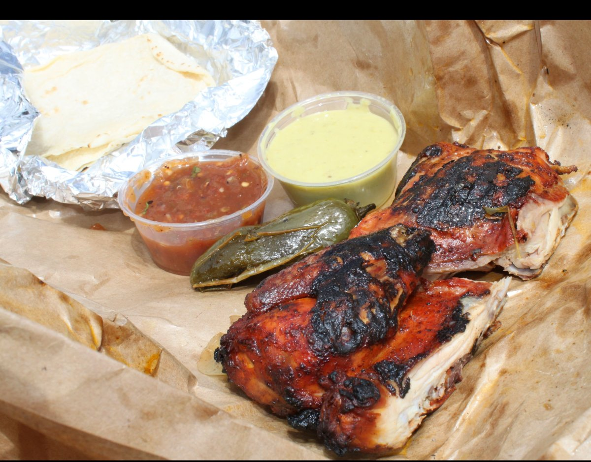 Fresas pasture-raised achiote half chicken, with fluffy, homemade corn tortillas and fresh salsa. The spicy green one is the