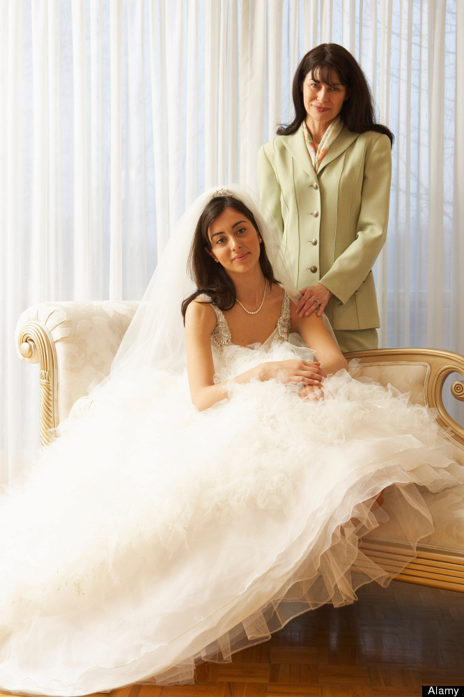 You always know where she is: right behind you. This mother-of-the-bride isn't going anywhere except wherever the bride goes.