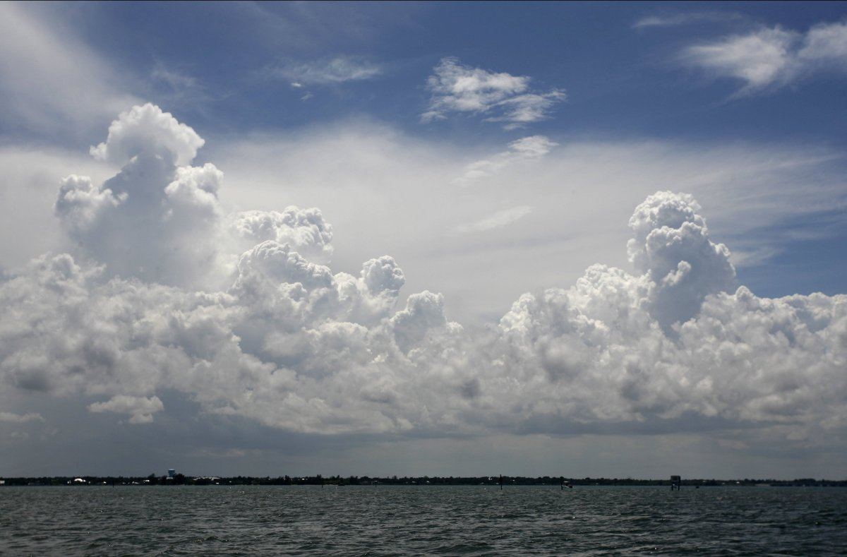 <em>Clouds fill the horizon in this view looking toward the west from a boat in the Indian River Lagoon near Melbourne Beach.