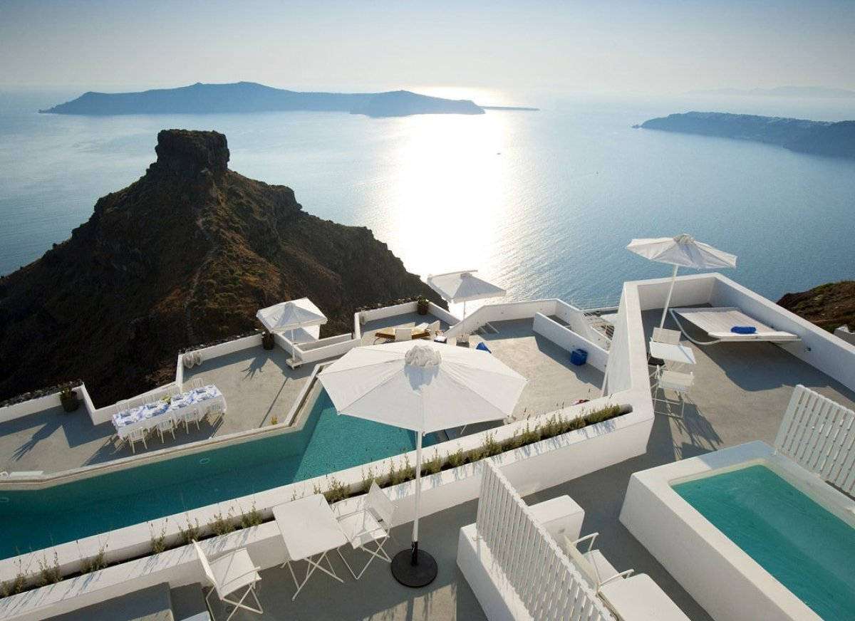 No list of classic cliffside dwellings could possibly be complete without a mention of Santorini — it's got plenty, but <a hr