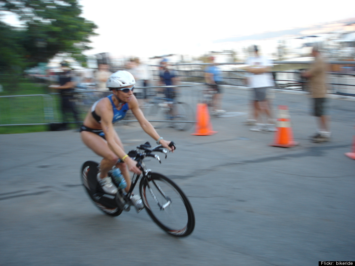 I'm a decent runner, but only an okay swimmer and a one-lap-around-the-park-in-a-sundress biker. Still, there's something abo