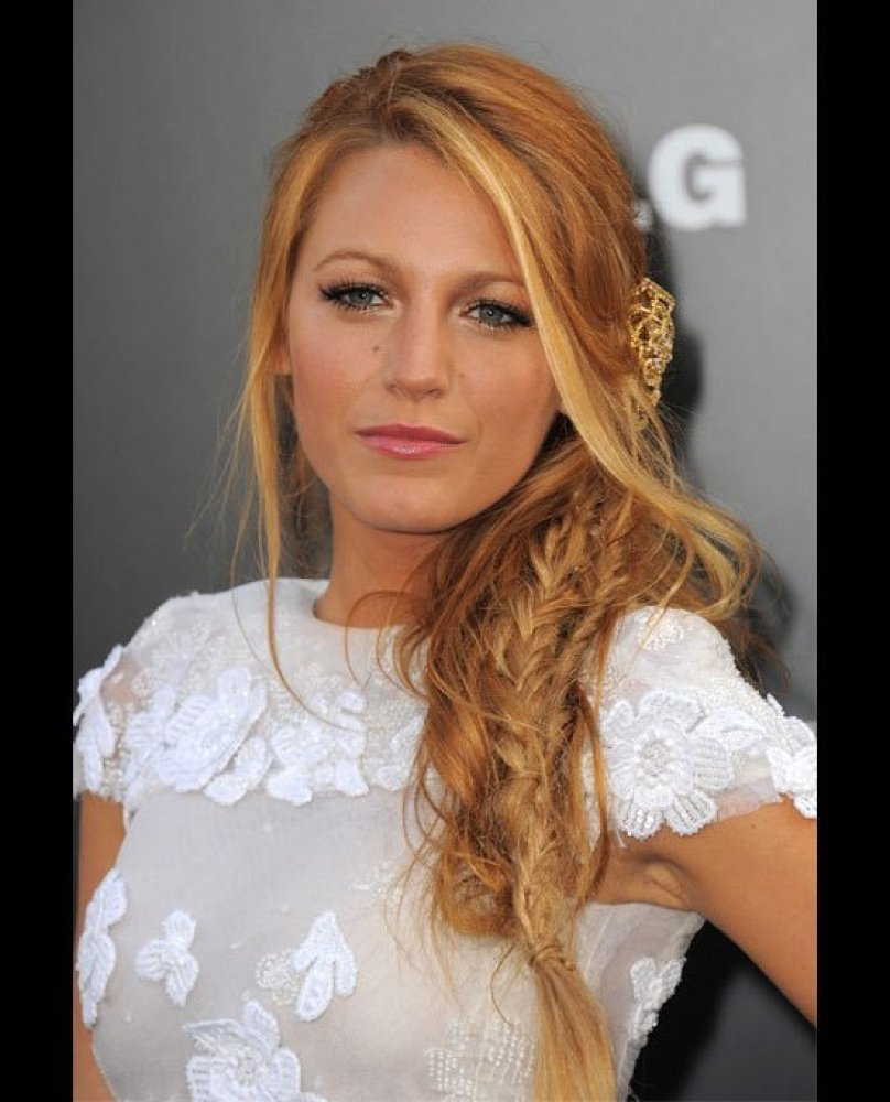 The <em>Gossip Girl </em>star's twisted fishtail braid is perfectly undone giving it a very sexy, beachy look. The gold hairp