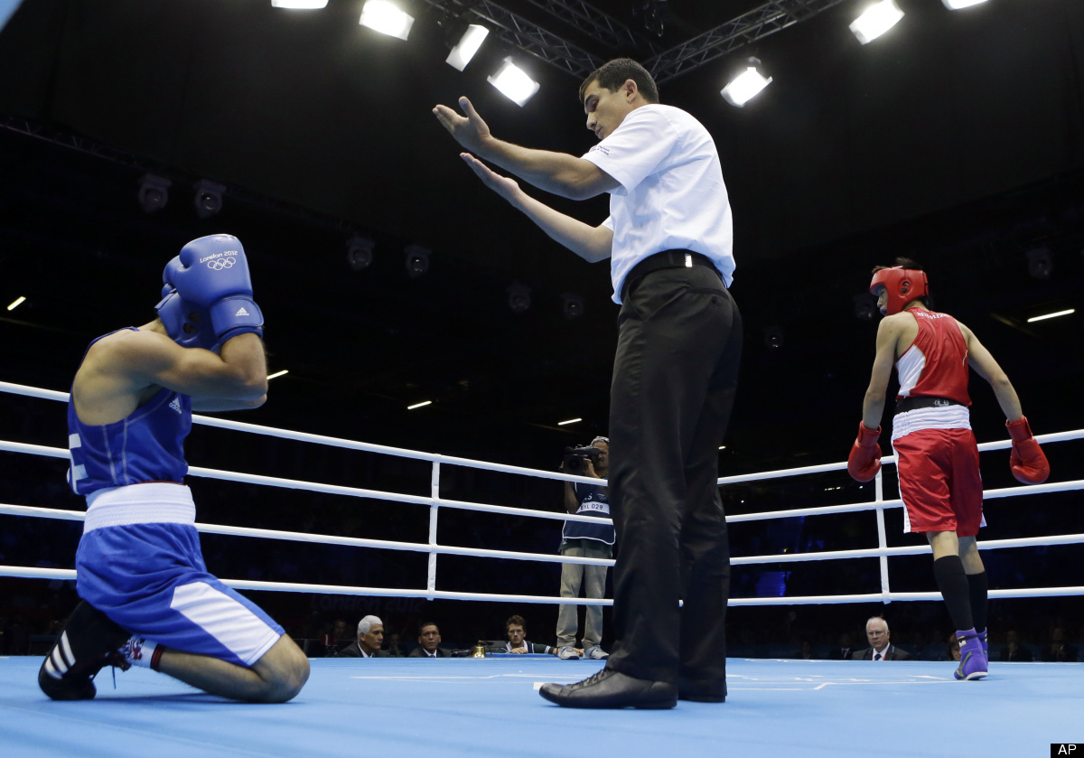 Japan's Satoshi Shimizu waits for Azerbaijan's Magomed Abdulhamidov to get up after a knock down during a bantamweight 56-kg