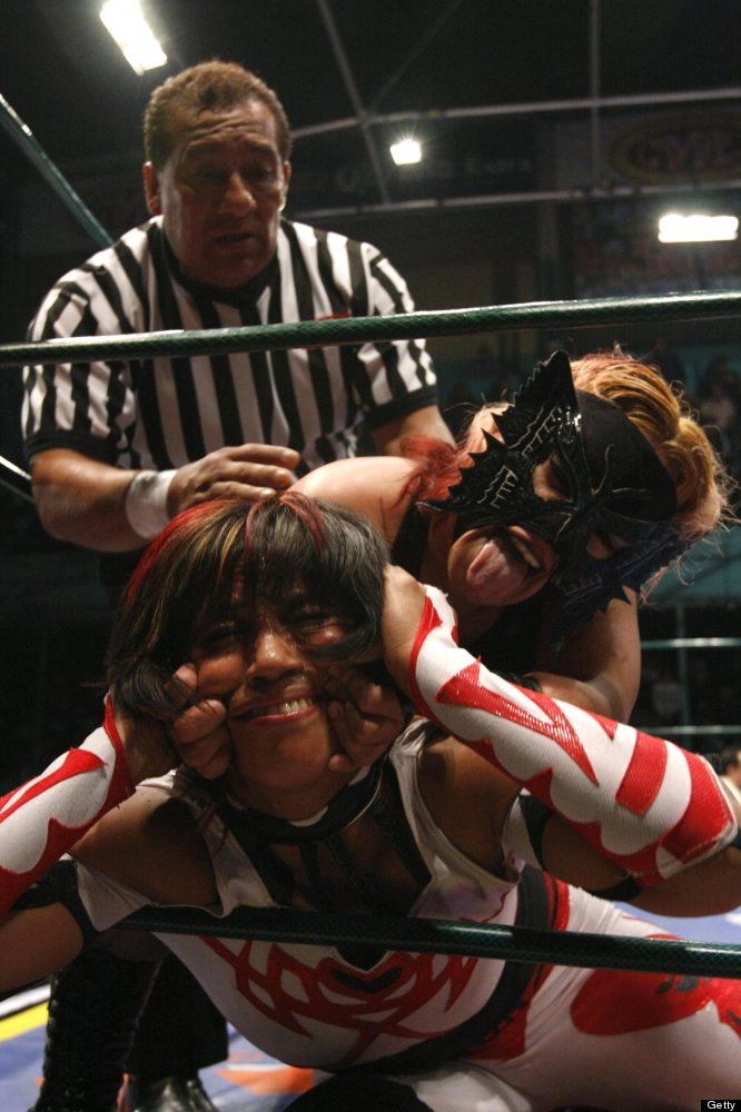 Two women fight during a combat of 'Lucha Libre' in Puebla, Mexico, on February 1, 2010. 'Lucha Libre' is authentic Mexican f