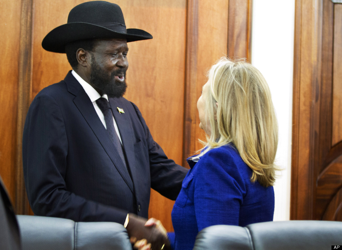 Secretary of State Hillary Rodham Clinton is greeted by South Sudan President Salva Kiir at the Presidential Office Building
