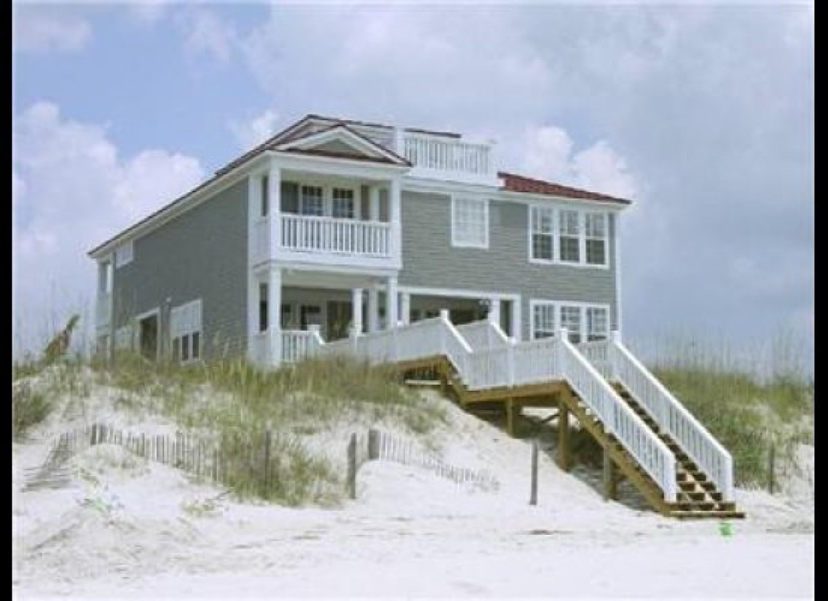 This dreamy 7-bedroom rental in Pawley's Island is all porch – one side of the house overlooks the creek; the other, the ocea