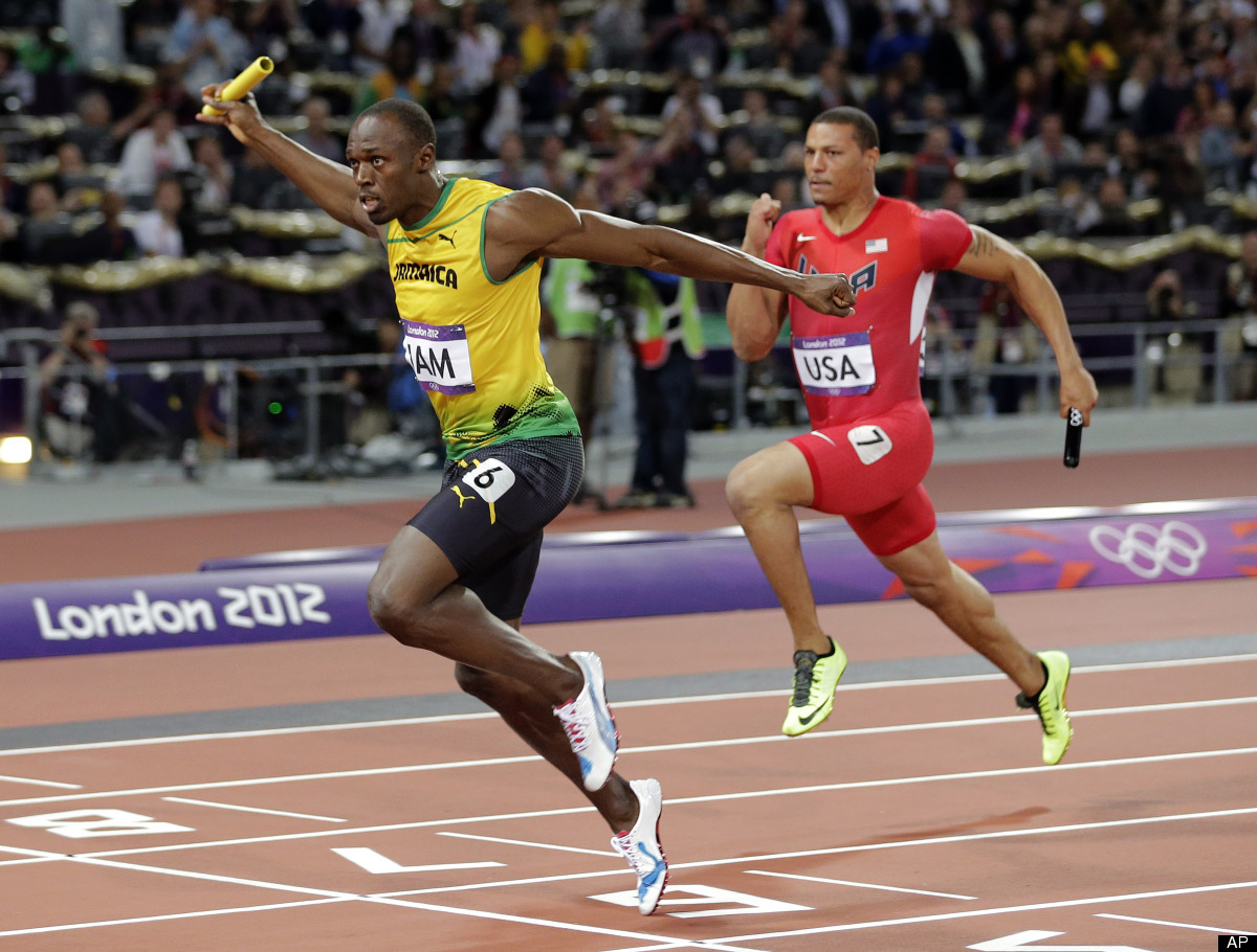 Jamaica's Usain Bolt, left, crosses the finish line ahead of Ryan Bailey of the United States in the men's 4x100-meter relay