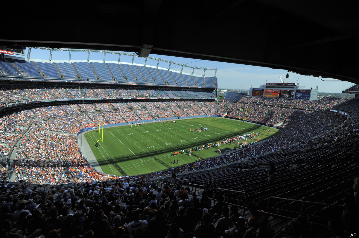 Denver Broncos fans pack the stadium to watch practice during NFL football training camp on Saturday, Aug. 4, 2012, in Denver