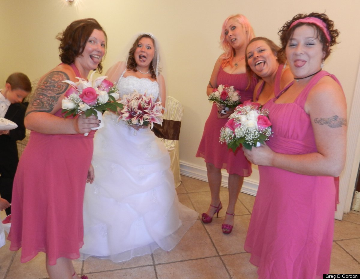 This is a posed picture but I thought it was cute. I asked the bride and bridesmaids to stick out their tongue. They did not