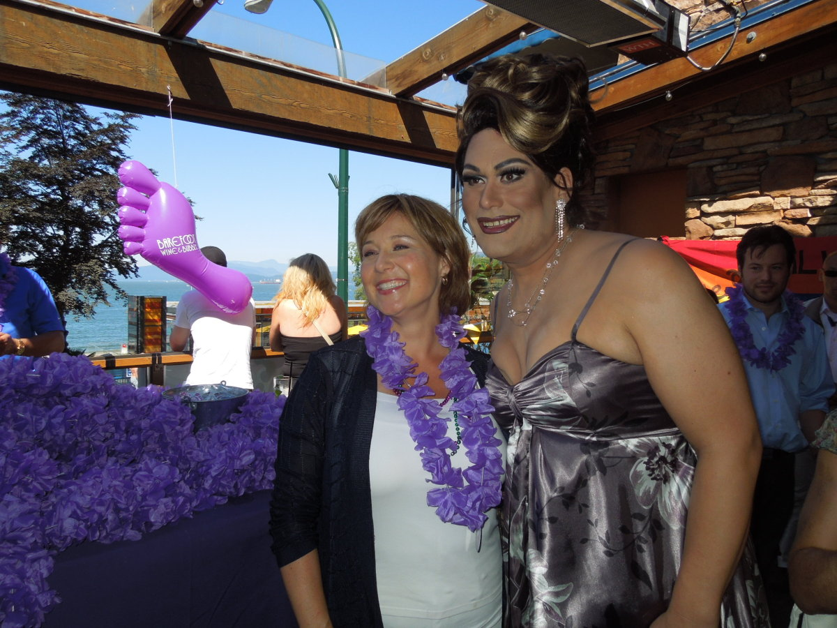 British Columbia Premier Christy Clark shares a hug with Vancouver 2012 Pride Parade MC Joan-E.