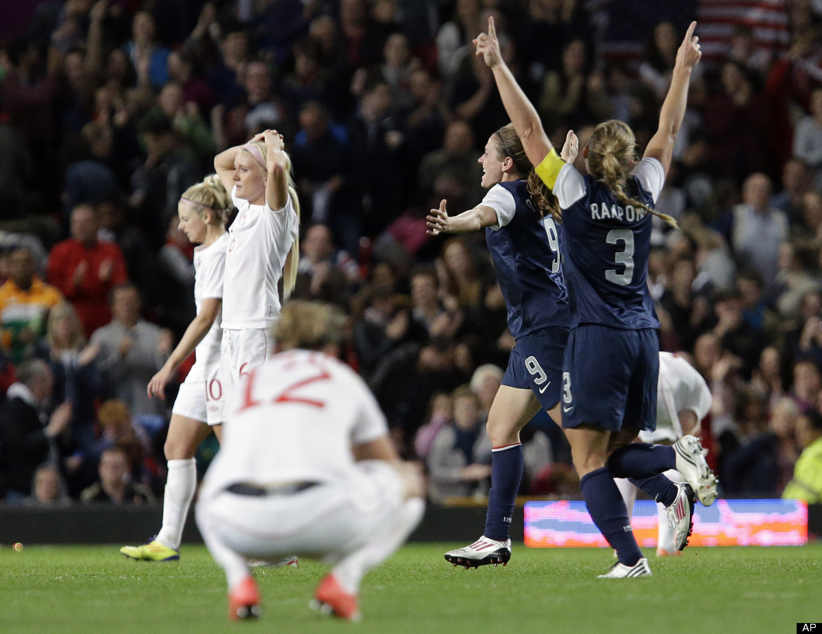 The United States' Heather O'Reilly, center right, and her teammate Christie Rampone, right, celebrate their win against Cana