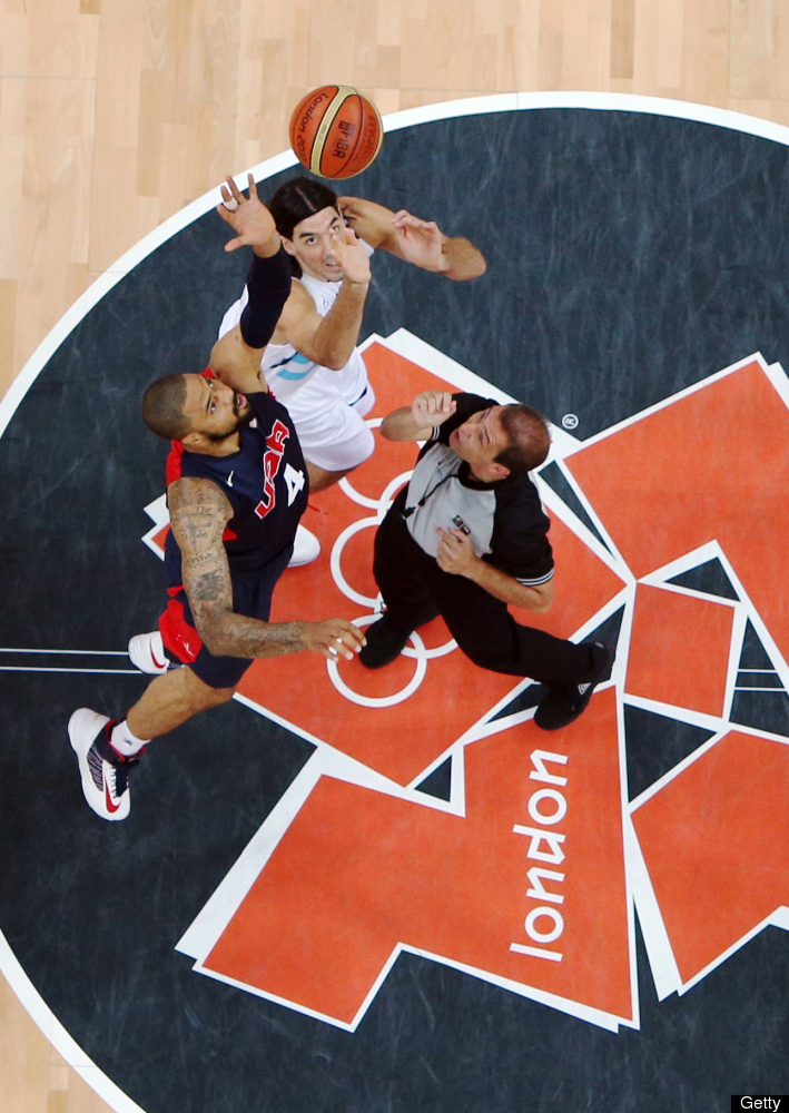 Tyson Chandler #4 of United States jumps the ball up against Luis Scola #4 of Argentina during the Men's Basketball Prelimina