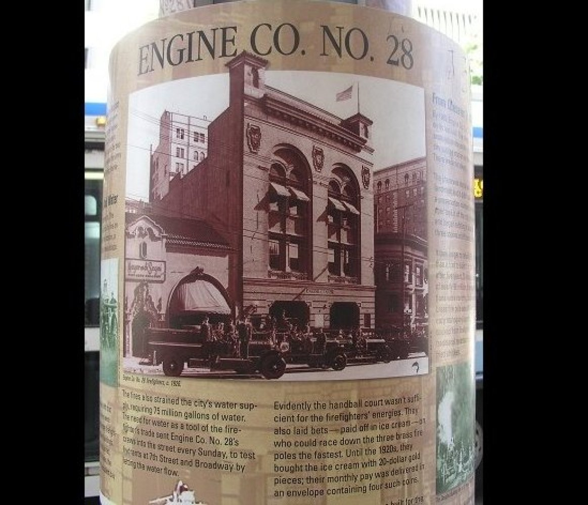The history of the old fire station is displayed on signage outside the building.