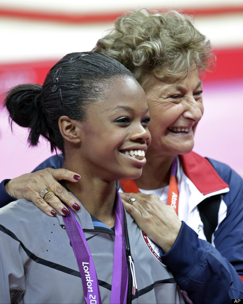 Marta Karolyi, foreground, U.S. national women's gymnastics team coordinator, right, stands with U.S. gymnast and gold medall