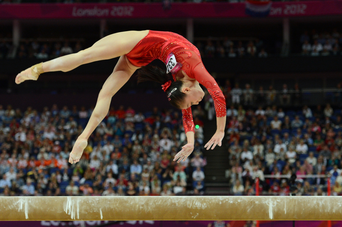 China's gymnast Sui Lu performs during the women' s beam final of the artistic gymnastics event of the London Olympic Games o