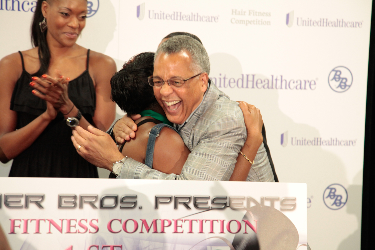 Dr. Reed Tuckson hugs stylist Linette Battle, who took home the $5,000 grand prize. Runners-up include:  2nd: Camilla Brown