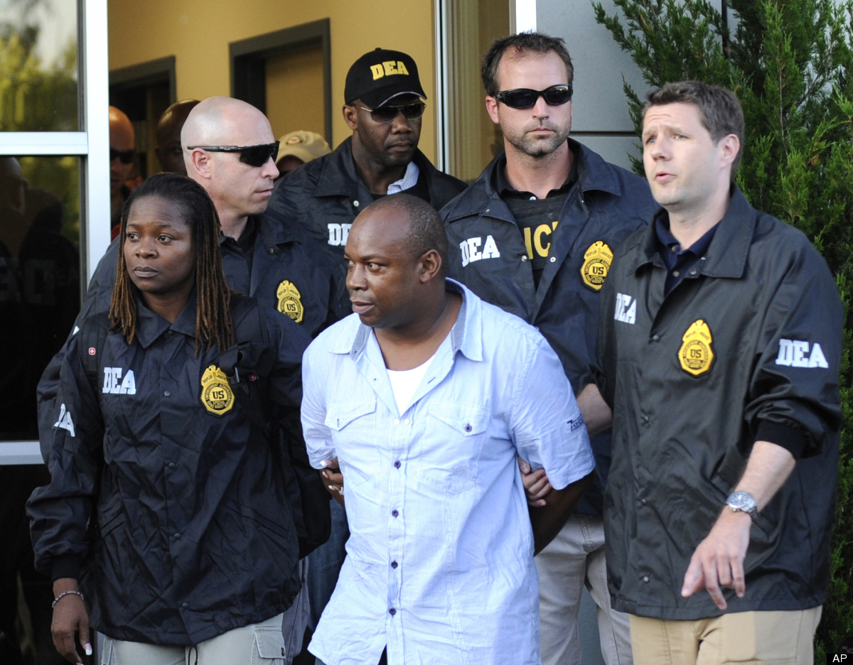 """FILE - In this June 24, 2010 file photo, DEA agents bring Jamaican gang leader Christopher """"Dudus"""" Coke From Westchester Coun"""