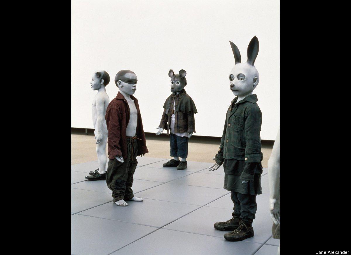 Jane Alexander, Bom Boys (detail), 1998. Fiberglass sculptures, found clothing, and fiberboard squares. Dimensions variable.