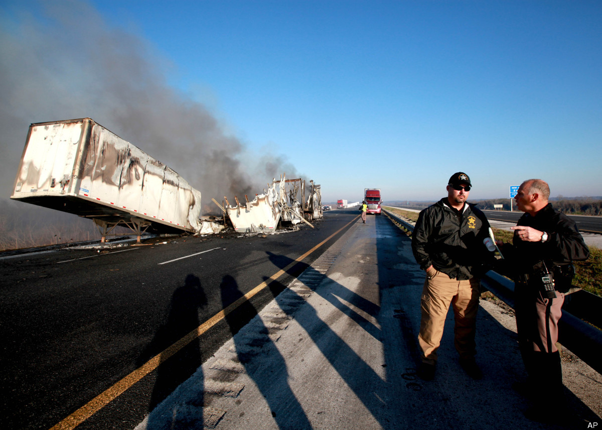 Officials work at the scene of a multi-vehicle wreck on Interstate 75 at Paynes Prairie on Sunday, Jan. 29, 2012, south of Ga