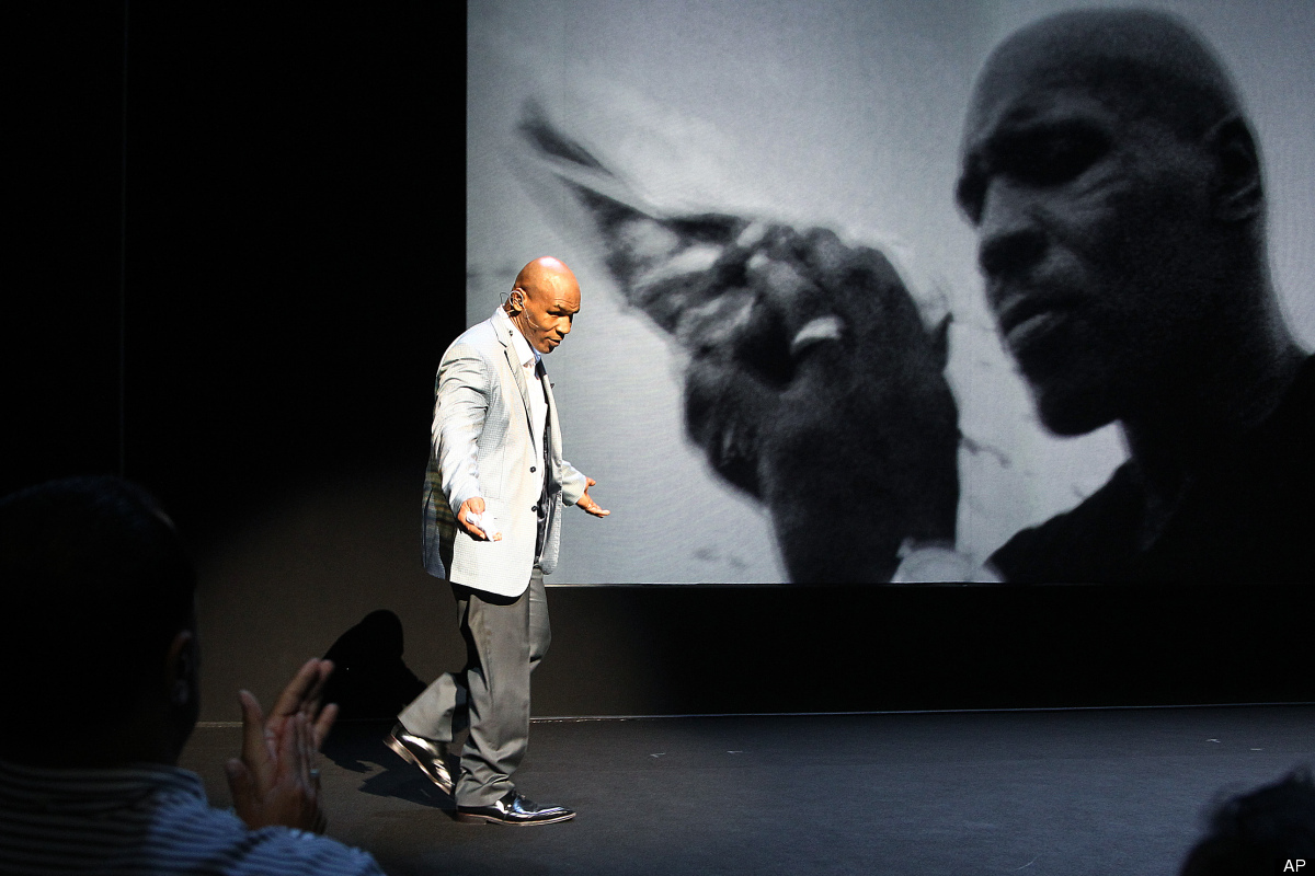 """Former boxer Mike Tyson takes part in a curtain call following his """"Mike Tyson: Undisputed Truth"""" performance on Thursday, Au"""