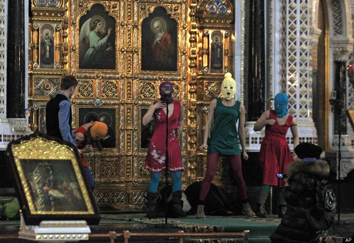 In this Feb. 21, 2012, file photo, members of the Russian radical feminist group Pussy Riot try to perform at the Christ the