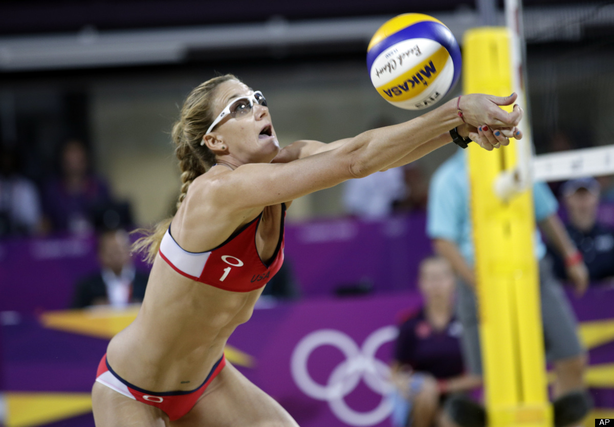 Kerri Walsh Jennings sets the ball during the women's Gold Medal beach volleyball match between two United States teams at th