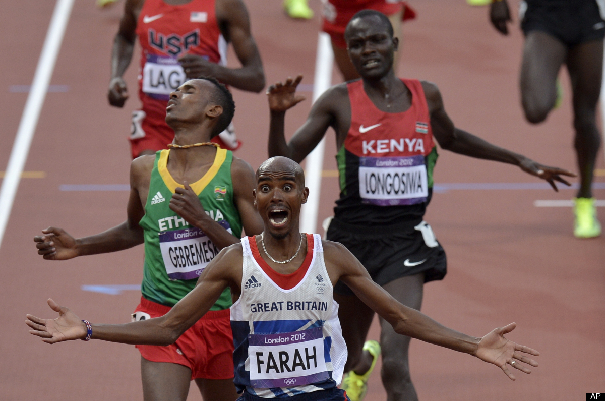 Britain's Mohamed Farah celebrates as he crosses the finish line to win in the men's 5000-meter final during the athletics in