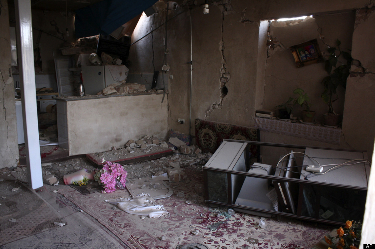 Ruins of a house is seen after an earthquake in the city of Varzaqan in northwestern Iran, on Saturday, Aug. 11, 2012. A 6.2-