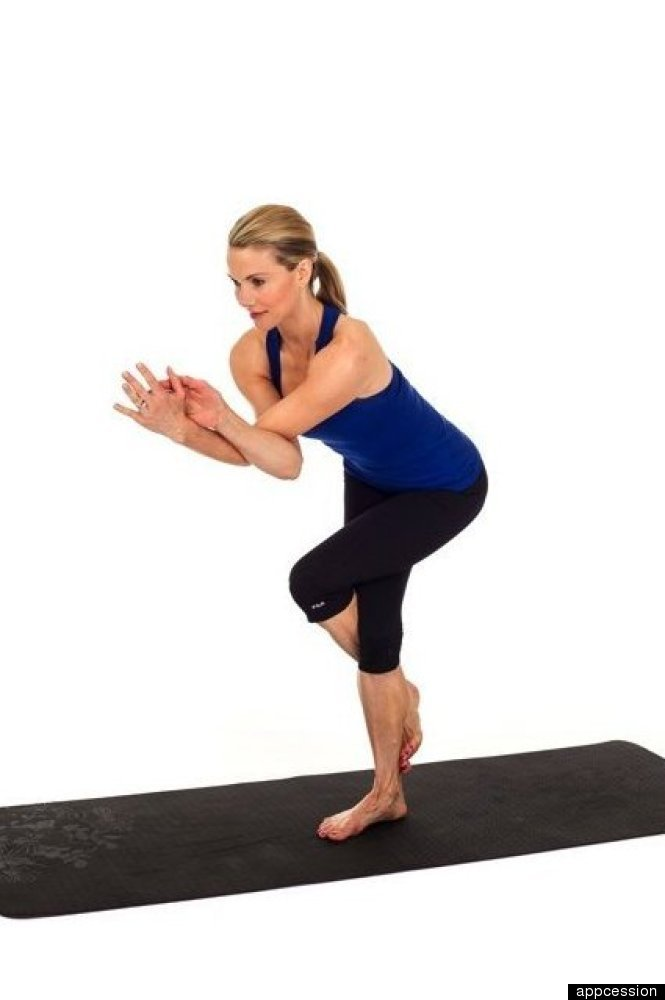 Wrap your left arm over your right arm as high up as possible, then hinge at the elbows and try pressing your palms together.