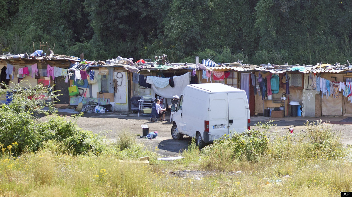 This is a Friday Aug. 10, 2012. file photo of a Roma encampment is set up near a highway in Clamart, west of Paris, Police of