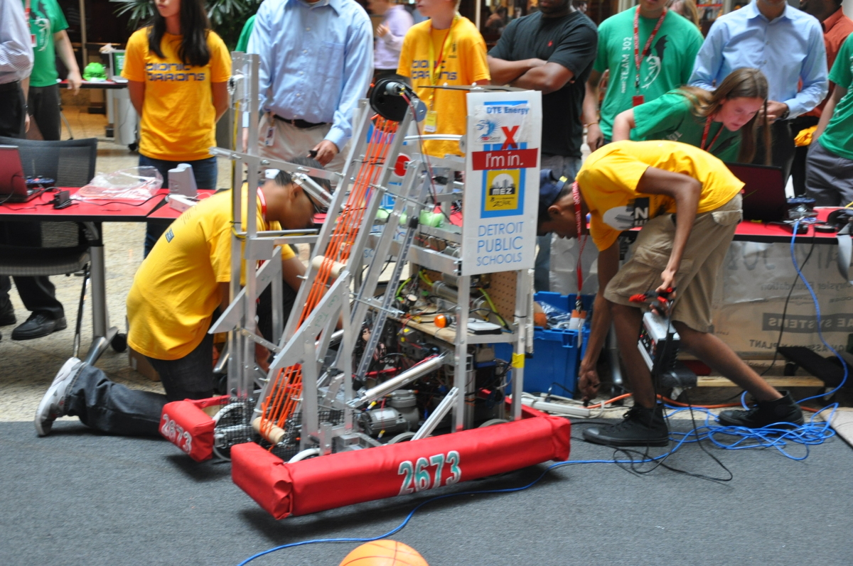 Metro Detroit high school robotics show off their basketball shooting bots at an exhibition held at Detroit's Compuware build