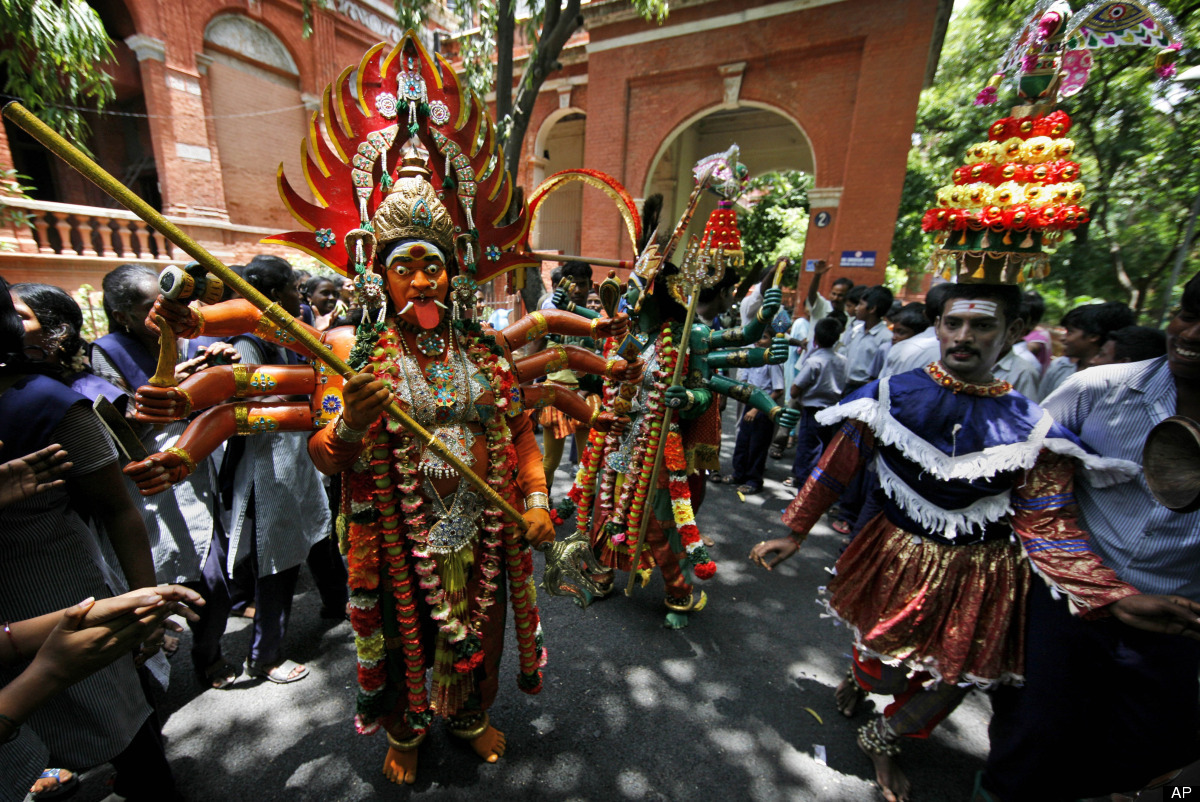 An Indian Kaliyattam artist wearing traditional costume performs for students at a school in Chennai, southern India, Thursda