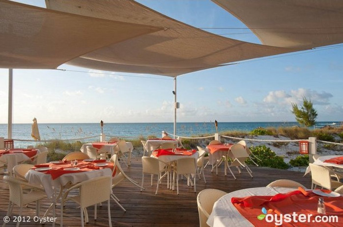 """Specializing in fresh seafood and Caribbean flavors, the <strong><a href=""""http://www.oyster.com/turks-and-caicos/hotels/the-a"""