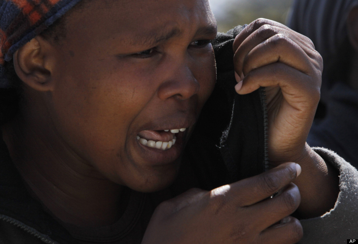 An unidentified woman cries Friday Aug. 17, 2012 as she protests against the police opening fire Thursday and killing and inj