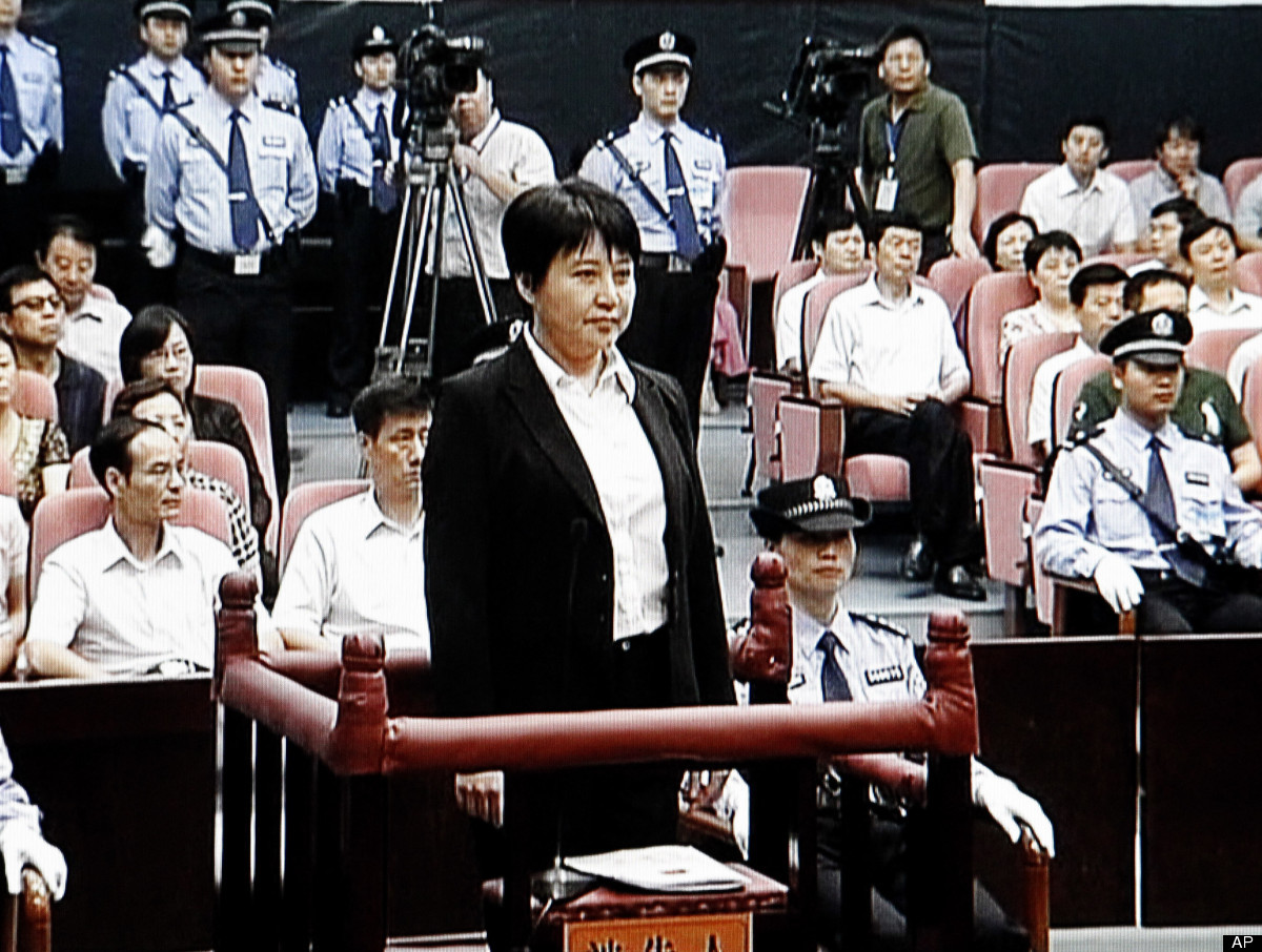 In this Aug. 9, 2012 file video image taken from CCTV, Gu Kailai, center, the wife of disgraced politician Bo Xilai, stands d