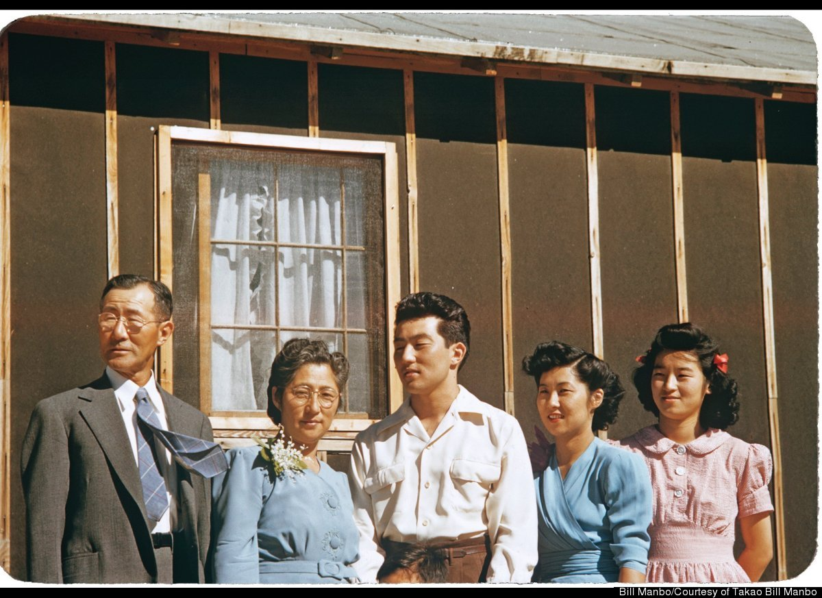 In a family portrait, Junzo Itaya's tie flips in the Wyoming wind. From left to right: Junzo Itaya, Riyo Itaya, Sammy Itaya,