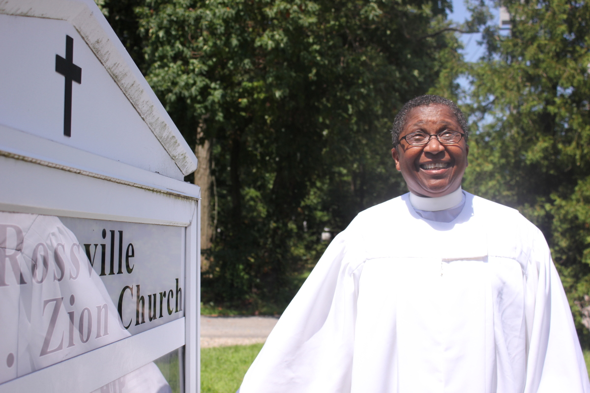 Reverend Janet Jones standing outside of Rossville A.M.E. Zion Church after her Sunday service.